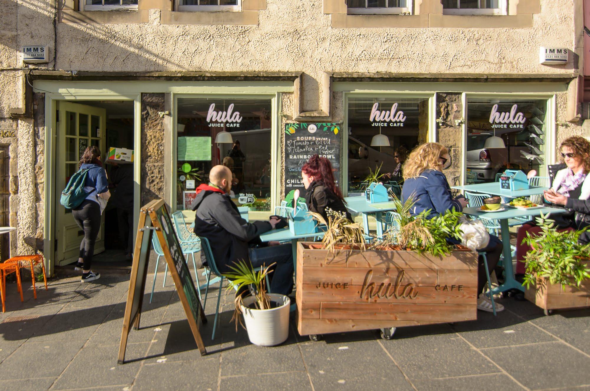 People enjoying the sun outside Hula Juice Cafe