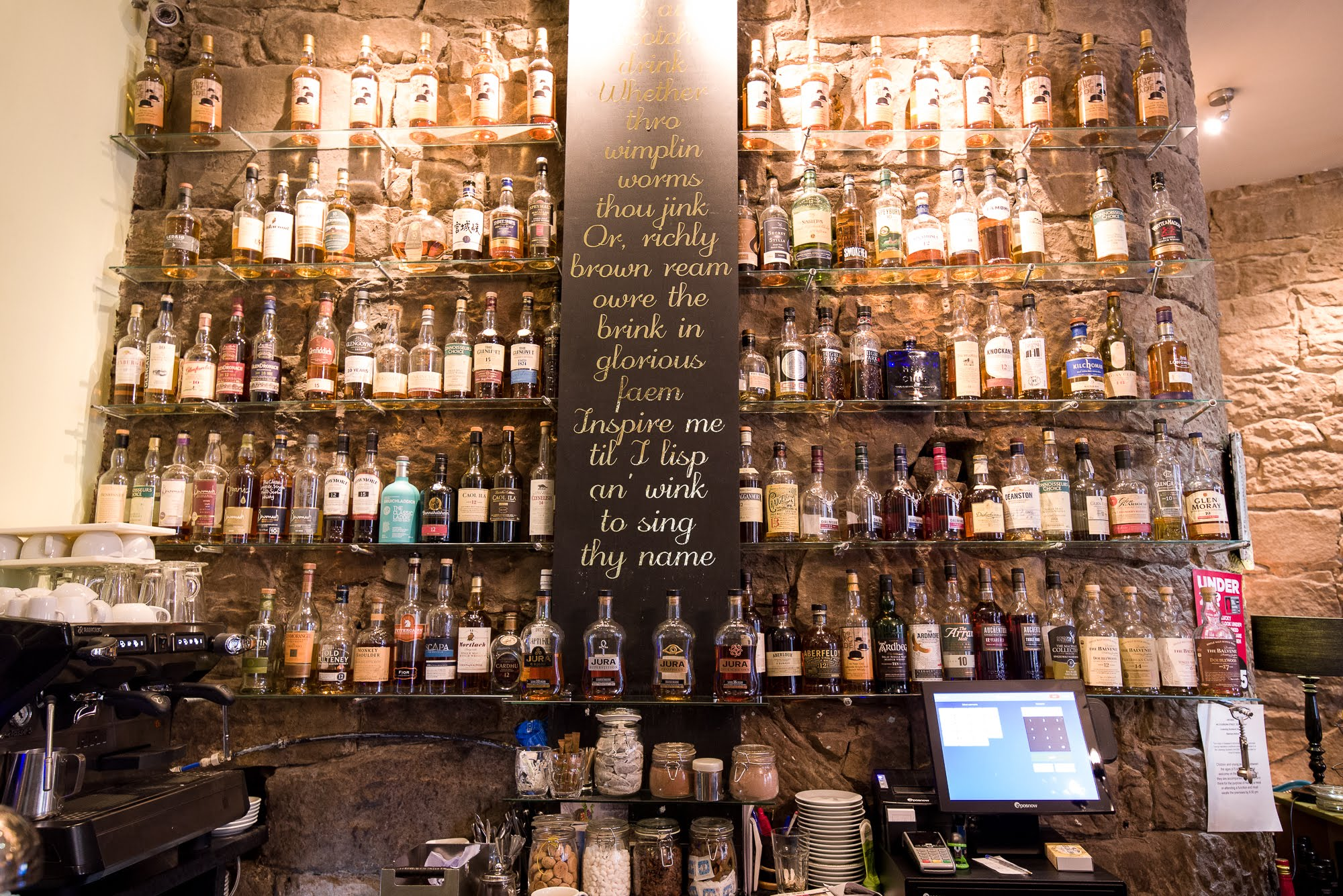 All the whiskies on the shelves in The Arcade Haggis and Whisky House.