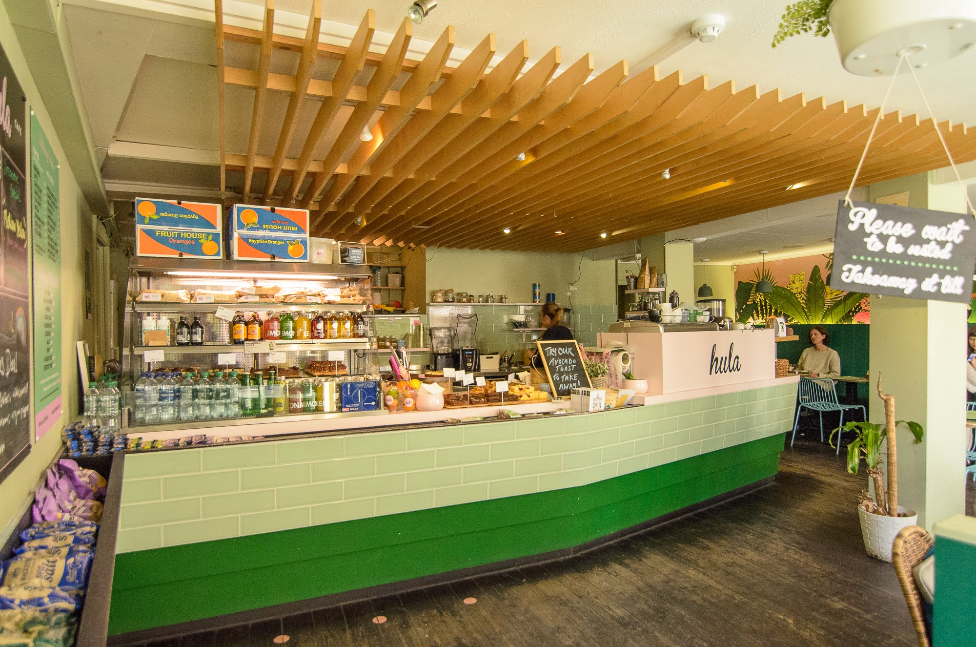 Hula Juice Cafe is decorated in a two tone green palette